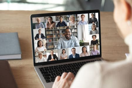 Laptop screen with people on a videoconference